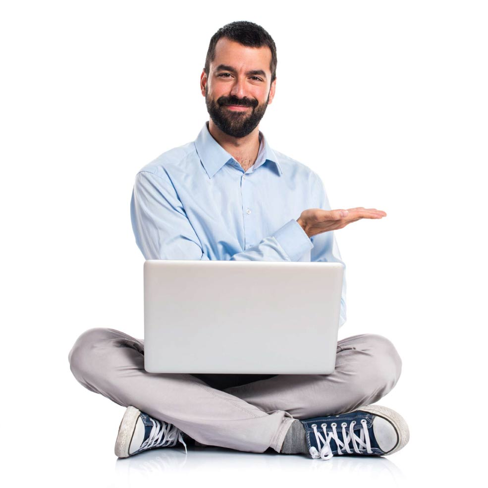 man sitting with a laptop